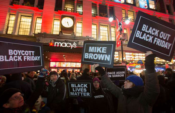 Reuters Protesters hold signs aloft outside Macy's before the kick off of Black Friday sales in New York November 27, 2014. Select stores opened Thursday to kick off the Black Friday sales, with the Friday…