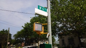 Picture of street sign corner of Ave T & West 6th Brooklyn, across from house of Officer Wejian Liu. Sign to be revealed during upcoming planned ceremony.