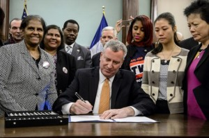 Mayor de Blasio signs the bill in February during a ceremony in the City Council chamber at City Hall.
