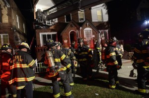 Firefighters gather at the Avenue P home where the fire erupted early Monday.